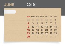June 2019 - Monthly calendar on brown paper and wood background with area for note. Vector illustration royalty free illustration