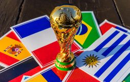 FIFA World Cup trophy. June 6, 2018 Moscow, Russia. FIFA World Cup trophy on the background of the flags of Brazil, Uruguay, France, Spain, Germany royalty free stock photos