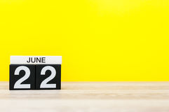 June 22nd. Day 22 of month, calendar on yellow background. Summer day. Empty space for text Stock Photography