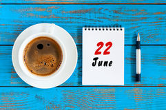 June 22nd. Image of june 22 , daily calendar on blue background with morning coffee cup. Summer day, Top view Royalty Free Stock Image
