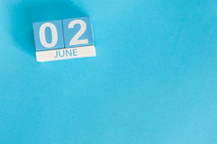 June 2nd. Image of june 2 wooden color calendar on blue background.  Summer day, empty space for text Royalty Free Stock Photo