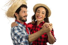 June Party is Festa Junina in Brazil.Cheerful couple is dancing to the traditional songs of June party. Man with beard and woman. June Party or Festa Junina in stock photo