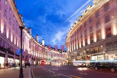 2016 June 16 Popular tourist Regent street with flags union jack in night lights. Popular tourist Regent street with flags union jack in night lights royalty free stock image