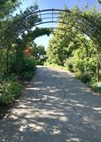 Pathway through the Gardens with arbor. royalty free stock image