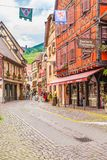 18 June 2012. Ribeauvillé village in Alsace. Famous wine route. 18 June 2012. Ribeauvillé  village with colorful traditional half-timbered french houses Royalty Free Stock Images
