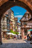 18 June 2012. Riquewihr in Alsace. Famous wine route. 18 June 2012. Riquewihr village with colorful traditional half-timbered french houses, Alsace, France Royalty Free Stock Photography