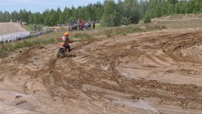 June 10, 2018 Russian Federation, Bryansk region, Ivot - Extreme sports, cross motocross. The motorcyclist enters the. Turn on the race track. Dirt is flying stock footage