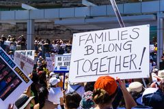 People gathered in front of the San Jose City Hall for the `Families belong together` rally. June 30, 2018 San Jose / CA / USA - People gathered in front of the stock photography