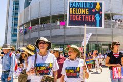 People gathered in front of the San Jose City Hall for the `Families belong together` rally stock photos