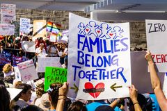 People gathered in front of the San Jose City Hall for the `Families belong together` rally stock image