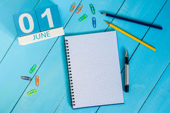 June 1st. Image of june 1 wooden color calendar on blue background.  First summer day.  Royalty Free Stock Image