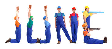June staff. Group of young people wearing different color uniforms and hard hats forming June word - isolated on white background - calendar concept Royalty Free Stock Image