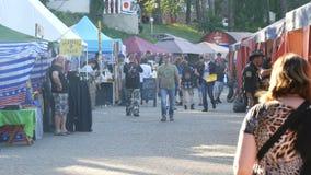 June 1, 2018 - Svidivok village, Ukraine: Tarasova Gora motor festival, bikers rest on the food court. June 1, 2018 - Svidivok village, Ukraine: Tarasova Gora stock footage