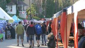 June 1, 2018 - Svidivok village, Ukraine: Tarasova Gora motor festival, bikers rest on the food court. June 1, 2018 - Svidivok village, Ukraine: Tarasova Gora stock video footage