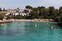 June 16th, 2017, Cala D`or, Mallorca, Spain - view of the beach with people in the water Royalty Free Stock Photography