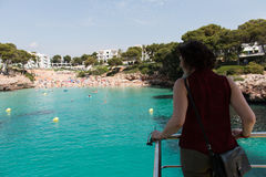 June 16th, 2017, Cala Ferrera, Mallorca, Spain - passenger at Starfish sea adventure boat ride admiring the beach. View Royalty Free Stock Photos
