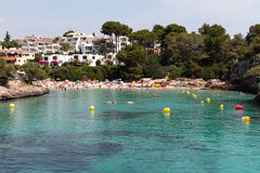 June 16th, 2017, Cala Ferrera, Mallorca, Spain - view of the beach from the sea with people in the water Stock Photography