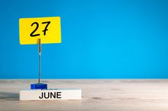 June 27th. Day 27 of june month, calendar on table with blue background. Summer time, empty space for text or template.  royalty free stock photo