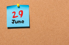 June 29th. Day 29 of month, color sticker calendar on notice board. Summer time. Empty space for text.  Royalty Free Stock Photos