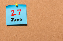 June 27th. Day 27 of month, color sticker calendar on notice board. Summer time. Empty space for text.  stock image