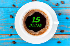 June 15th. Day 15 of month, everyday calendar written on morning coffee cup at blue wooden background. Summer concept Stock Image