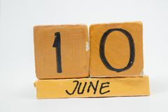 June 10th. Day 10 of month, handmade wood calendar isolated on white background. summer month, day of the year concept. June 10th. Day 10 of month, handmade wood royalty free stock image