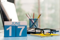 June 17th. Day 17 of month, wooden color calendar on outsource business background. Summer time. Empty space for text Stock Images