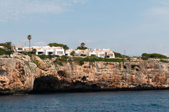 June 16th, 2017, Porto Colom, Mallorca, Spain - coastline view with houses Stock Images