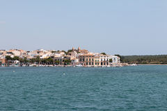 June 16th, 2017, Porto Colom, Spain - view of the Porto Colom Harbor and old town. From the sea Royalty Free Stock Photos