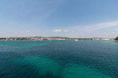 June 16th, 2017, Porto Colom, Spain - view of the Porto Colom Harbor and old town. From the sea Stock Photography
