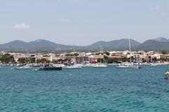 June 16th, 2017, Porto Colom, Spain - view of the Porto Colom Harbor and old town. From the sea Royalty Free Stock Photography