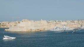 June 2016. Valletta, Malta. Boat floating in capital with beautiful waterfront view. Valletta, Malta. Boat floating in capital with beautiful waterfront view stock footage
