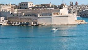 June 3 2016 Valletta, Malta. Yacht floating in Valletta waters slow motion dolly shot stock footage