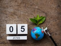 05 JUNE wooden calendar block, globe and stethoscope on wooden t royalty free stock photos
