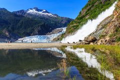 Juneau, Alaska. Mendenhall Glacier Viewpoint with reflection in the lake and waterfall royalty free stock images