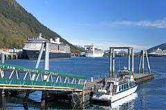 Juneau Port. Juneau, Alaska - May 21, 2013: Passenger cruise ships docked in Juneau Port during short Alaskan summer stock photos