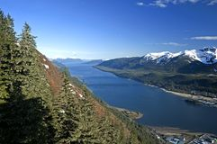 Juneau Port. Juneau, capital of Alaska state is completely surrounded by nature, mountains and the waters of Gastineau Channel. For most visitors, the only way royalty free stock image