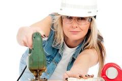 Jung Frau mit Tischlerbandsäge Stockfotos