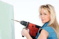 Jung Frauen mit Bohrgerät Lizenzfreies Stockfoto