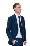 Jung und erfolgreich Hübscher junger Geschäftsmann, der beiseite auf lokalisiertem weißem Hintergrund schaut Stockfoto