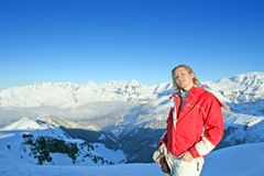 Jung woman in Alps. Happy people on the side of French Alps royalty free stock photo