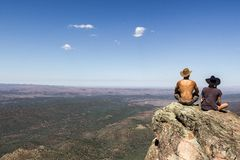 Jung women and men sitting on St Mary`s Peak from the Flinders Ranges National Park stock photos