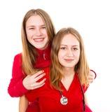 Junge Ärztin und ihre Schwester Lizenzfreie Stockbilder