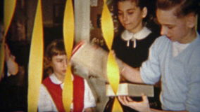 1954: Junge öffnet Weihnachtsgeschenk von Mokassinschuhen NEWARK, NEW-JERSEY stock video footage