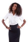 Junge AfroamerikanerGeschäftsfrau, die oben schaut Stockfotografie