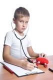 Junge als Doktor getrennt auf Weiß Lizenzfreie Stockfotos