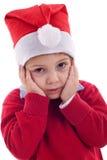 Junge als Weihnachtsmann ist besorgt lizenzfreies stockbild