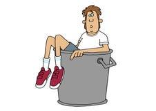 Junge angefüllt in einem Mülleimer stock abbildung