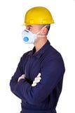 Junge Arbeitskraft mit protecnion Kleidung Lizenzfreies Stockfoto