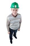 Junge Arbeitskraft mit Schutzsturzhelm Stockfoto